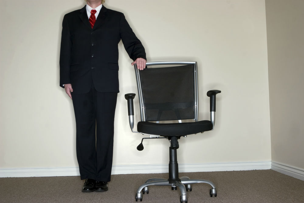 Business Man Offering Empty Chair